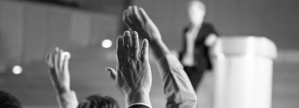 Conference of people raising their hands